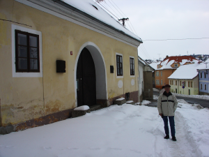 The author John Goris outside the home of Jan Hus